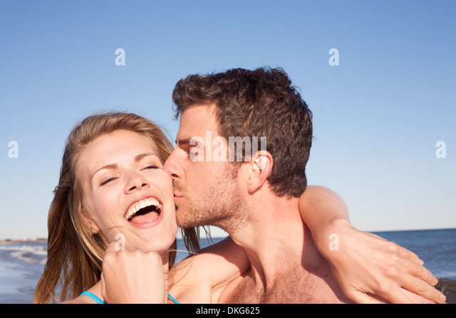 Close up portrait of couple on beach, Breezy Point, Queens, New York, USA - Stock-Bilder