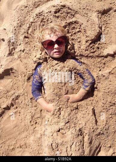Playing in the sand - Stock-Bilder