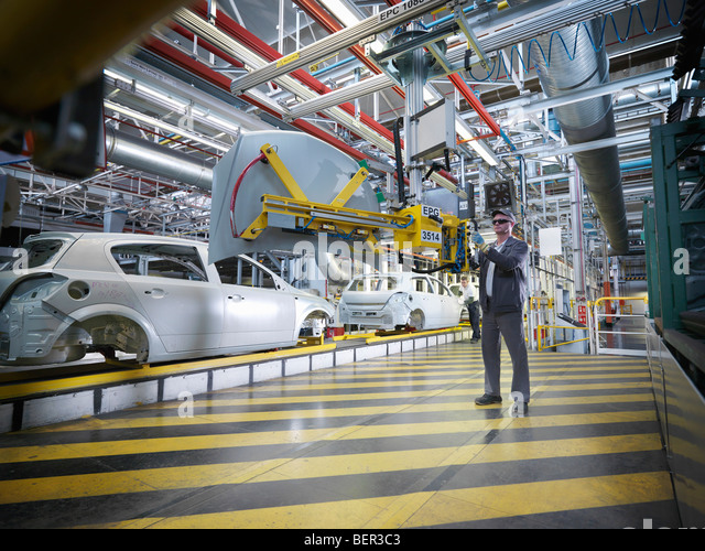 Car Plant Worker With Machinery - Stock Image