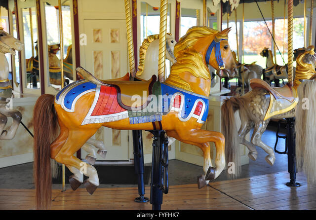 Children's roundabout, nostalgic carousel with wooden horses from 1910, Congress Park, Saratoga Springs, New - Stock-Bilder