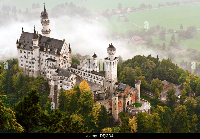Neuschwanstein Castle shrouded in mist in the Bavarian Alps of Germany. - Stock-Bilder