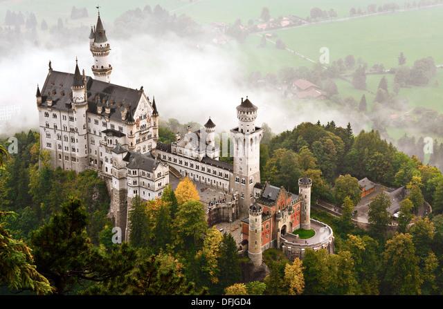 Neuschwanstein Castle shrouded in mist in the Bavarian Alps of Germany. - Stock-Bilder