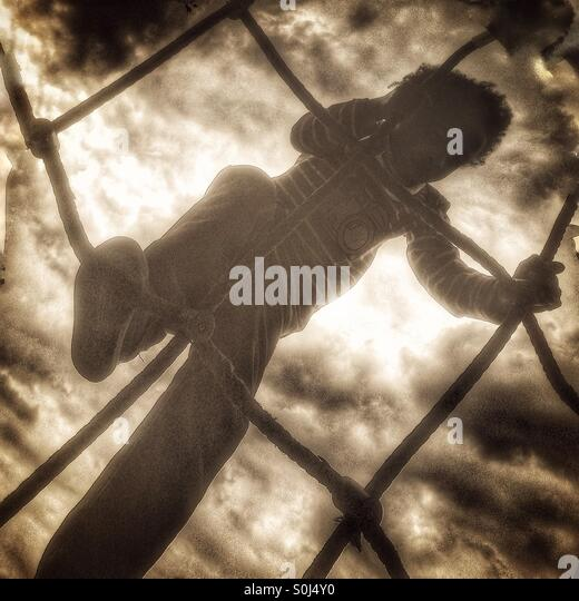 A little boy climbing - Stock Image