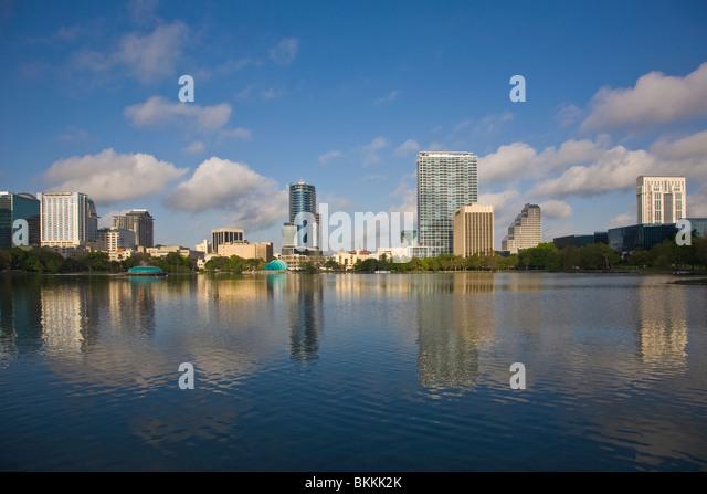 Modern architecture skyline of Orlando Florida reflecting in Lake Eola - Stock Image