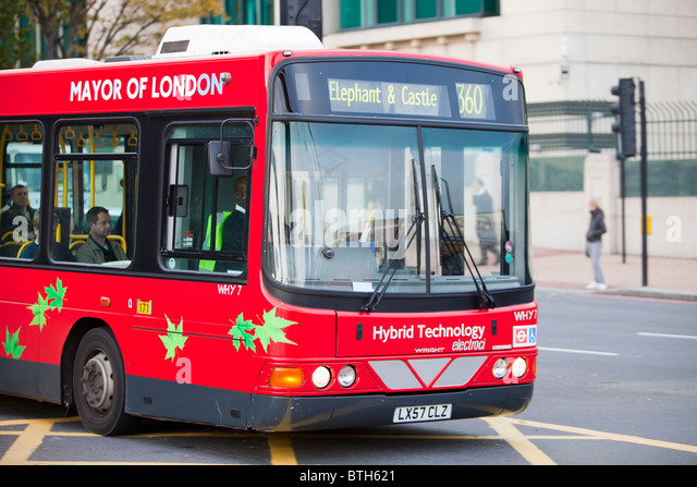 An electric hybrid technology bus in London. Part of Transports for London's commitment to reducing their carbon - Stock Image