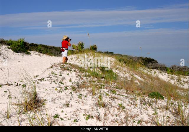 Florida Grayton Beach State Park sand dunes woman hiking nature trail - Stock Image
