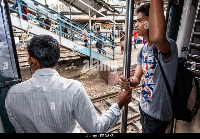 India Asian Mumbai Mumbai Central Local Railway Station Western Line train public transportation riders passengers - Stock Image