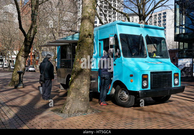 A food truck in Occidental Square Park  in the Pioneer Square district of Seattle, Washington, USA - Stock Image