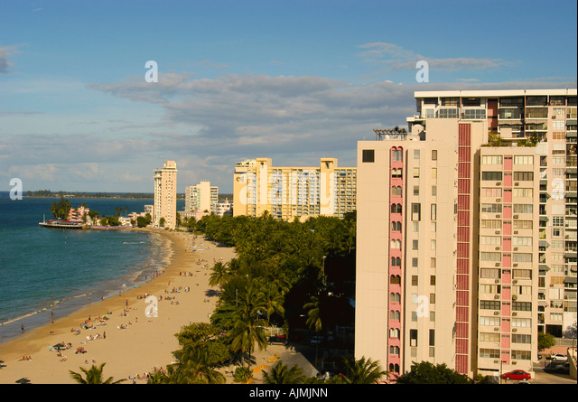 San Juan Puerto Rico, Caribbean islands, Isla Verde famous beach with sunbathers, aerial view - Stock Image