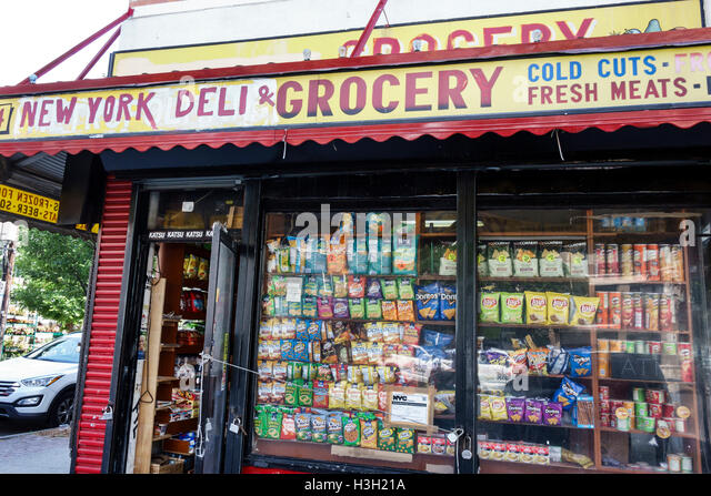 Brooklyn New York City NYC NY Williamsburg grocery store deli bodega shopping snacks window sign neighborhood business - Stock Image