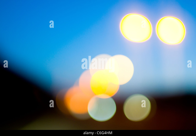 Abstract street lights at dusk - Stock Image