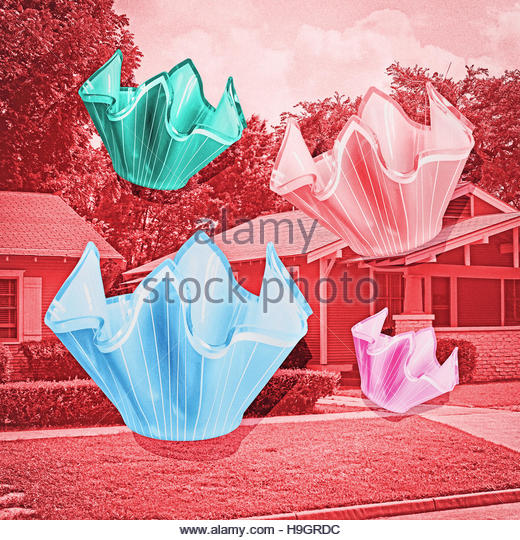 Vintage glass handkerchief vases with houses residential background - Stock Image