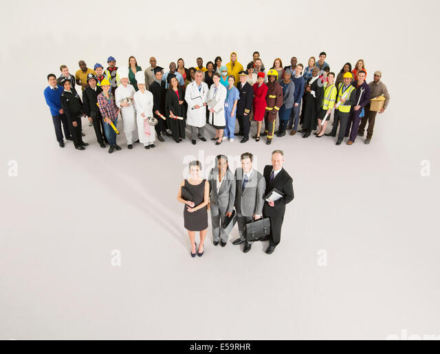 Workforce behind confident business people - Stock Image