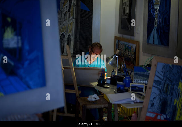 An artist paints in his studio in the Medieval quarter of Orvieto, Italy. - Stock Image