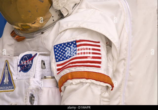 NASA astronaut space suit with American flag arm patch Kennedy Space Center Visitor Center, Florida - Stock Image