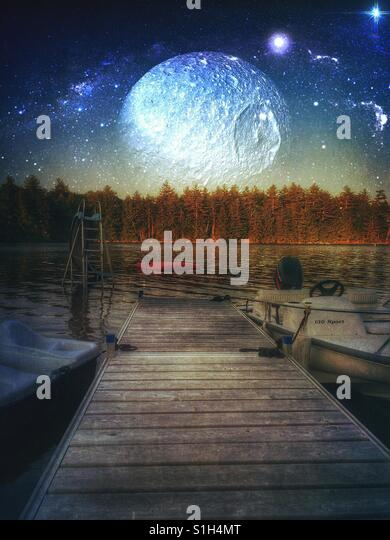 At The Dock Stars and Moon in the Sky - Stock Image