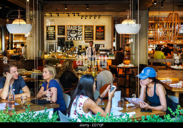 Illinois Chicago River North downtown North Clark Street Beatrix restaurant inside interior man woman couple Illinois - Stock Image