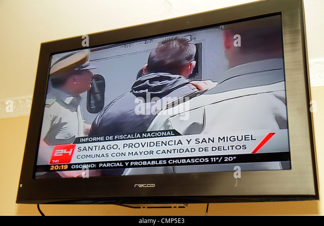 Chile Santiago television TV flat screen 24 Horas 24 Hours national news program media Spanish language logo broadcast - Stock Image