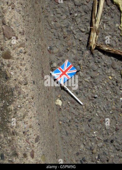 Sidmouth, Devon, 23rd June 2016 A tiny Union Jack flag lies in the gutter of a road in Sidmouth, Devon, as the nation's - Stock Image