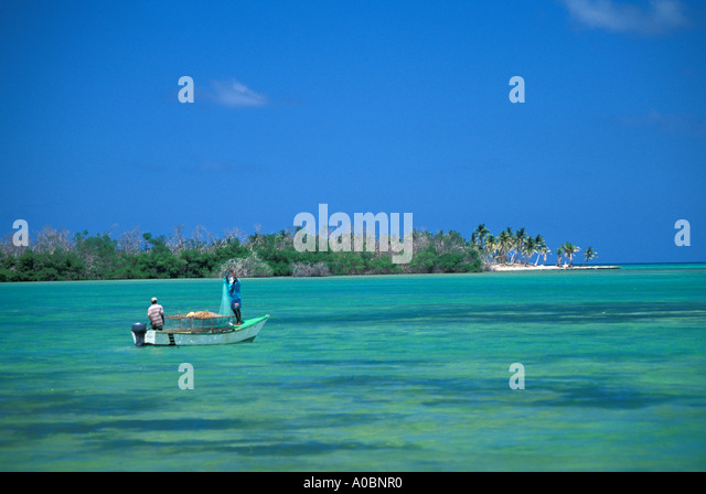 Dominican Republic coastline fishermen Punta Cana Resort - Stock Image