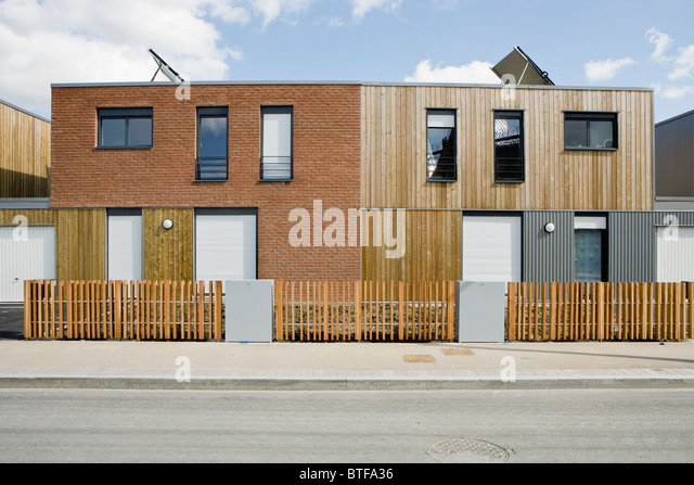 Apartment buildings with solar panels - Stock Image