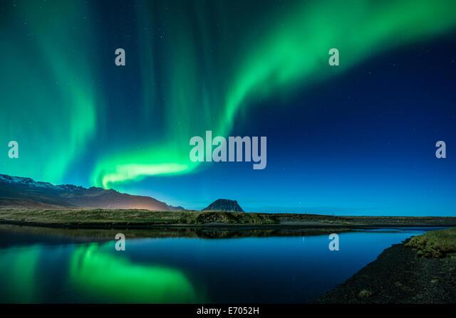 Aurora Borealis above Grundarfjordur, Mt. Kikjufell in centre, Snaefellsnes, Iceland - Stock-Bilder