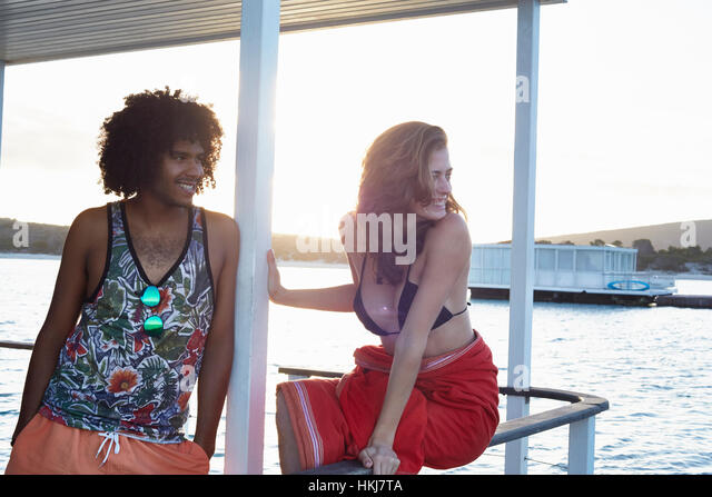 Young couple hanging out on summer houseboat - Stock-Bilder