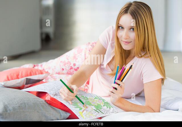 Woman coloring a mandala. - Stock-Bilder