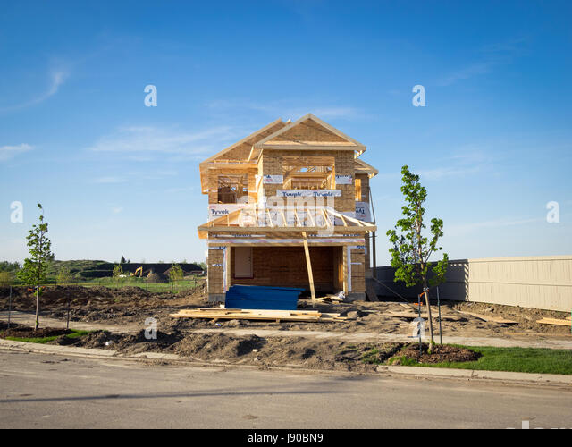 A two-storey residential house under construction in the Edmonton suburb of Beaumont, Alberta, Canada. - Stock Image