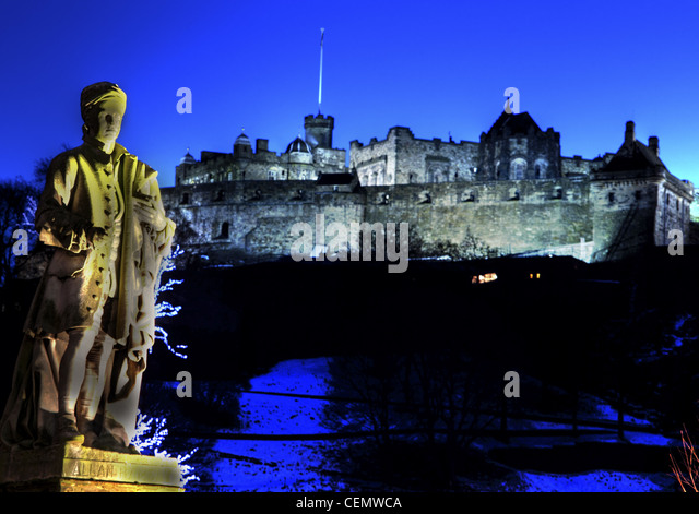 Allan Ramsey statue & Edinburgh Castle at Dusk just before night fall from Princes Street, Scotland, UK - Stock Image