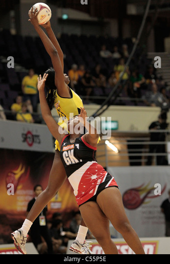 08.07.2011 Romelda Aiken of Jamaica(yellow) beats Alicia Liverpool to the ball during the Quarter-finals between - Stock Image
