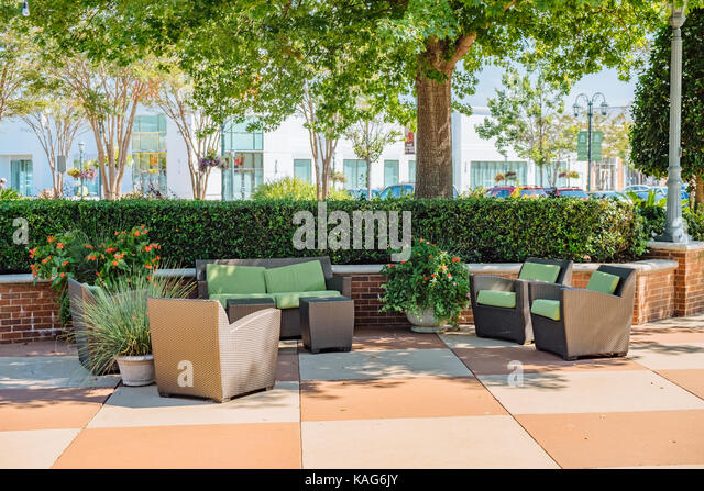 Empty seating area for shoppers at the The Shoppes at Eastchase, a popular open shopping center in Montgomery, Alabama, - Stock Image