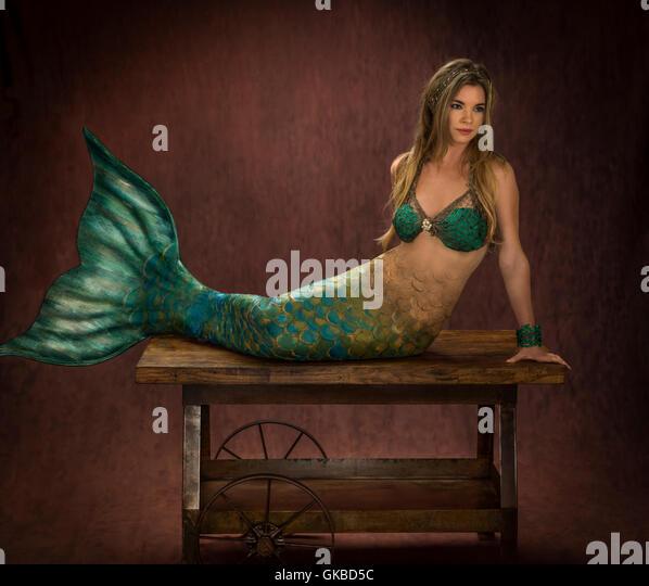 Mermaid sitting on a wheeled cart in studio, Virginia Beach, VA - Stock Image