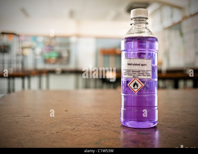 Methylated spirits bottle in school science laboratory. - Stock Image