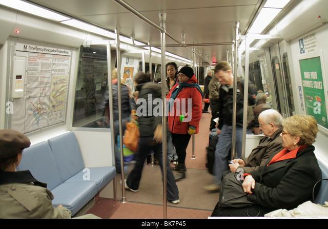 Washington DC Metro rapid transit system public transportation train stopped exit Black man woman couple senior - Stock Image