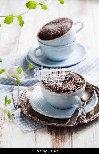 Chocolate cake in a coffee mug - Stock Image