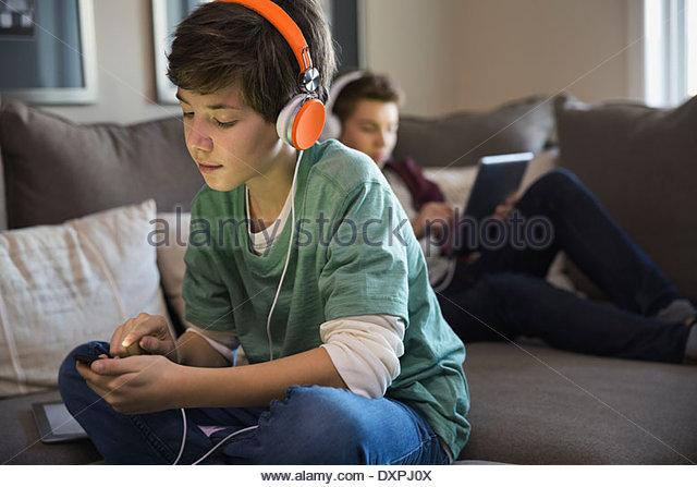 Boy listening to music on smart phone - Stock Image