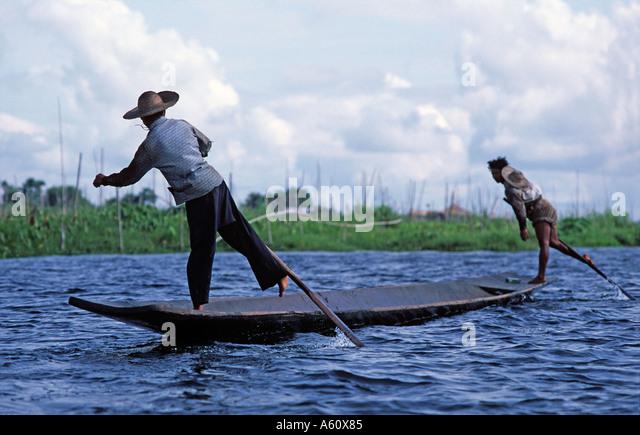 The leg rowing Intha fishermen of Lake Inle Shan State Burma - Stock Image