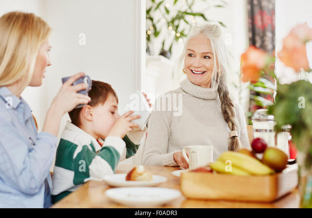 Three generation family having breakfast - Stock Image
