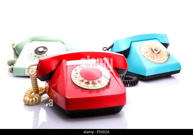 Set of vintage telephones isolated on white background - Stock Image