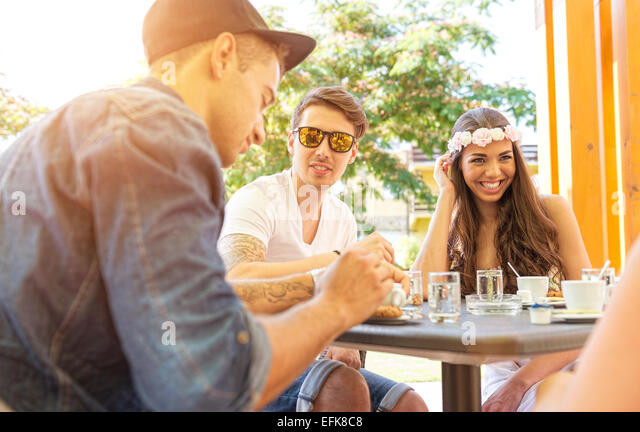 Young couple in the cafe terrace - Stock Image