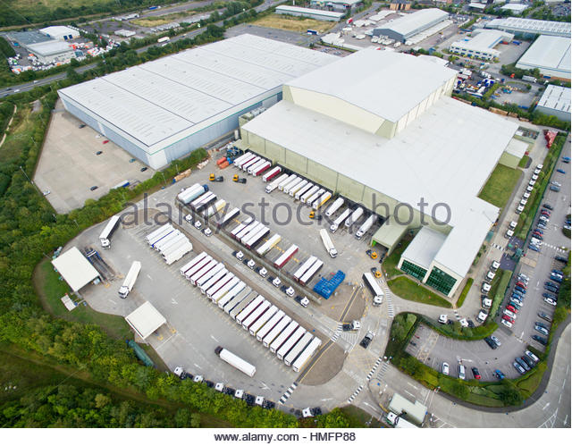 Aerial view factory HQ and commercial industry lorry semi-trucks - Stock-Bilder
