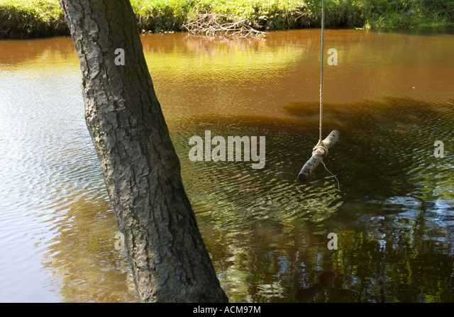 Rope swing over river stock photos rope swing over river for Swing over water