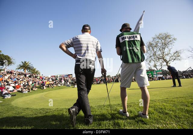 Feb. 17, 2013 - Los Angeles, California (CA, United States - John Merrick (L) and his caddie Ryan Goble play at - Stock Image