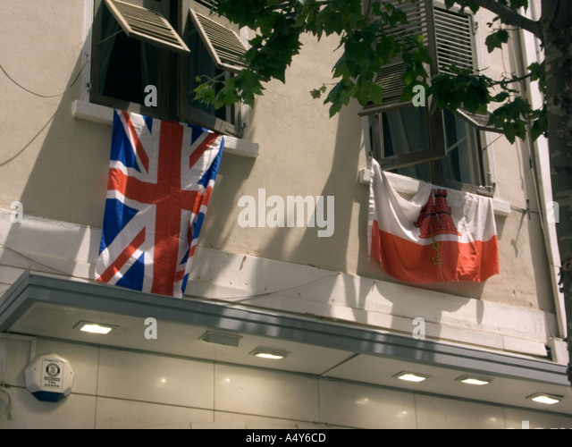 British and Gibraltar Flags hang form buildings to support 300 yeurs of British Rule, Gibralrar, Europe, - Stock Image