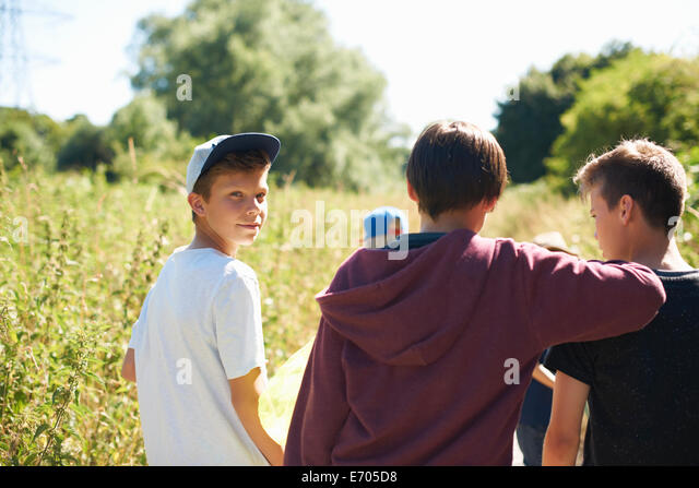 Portrait of boy wearing cap with friends - Stock-Bilder