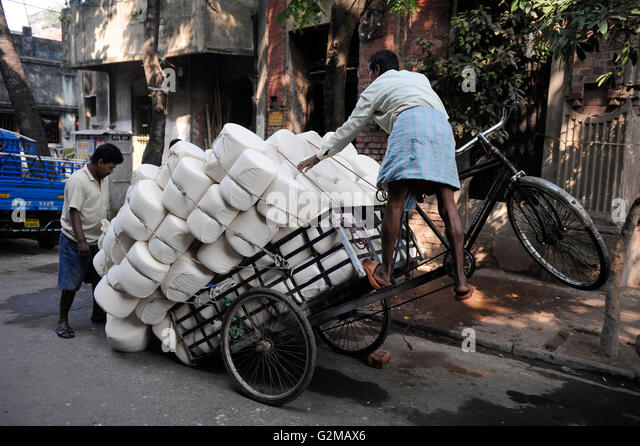 INDIA Westbengal, Kolkata, bicycle rickshaw three wheeler for transport of goods, cotton fabric / INDIEN, Westbengalen, - Stock-Bilder