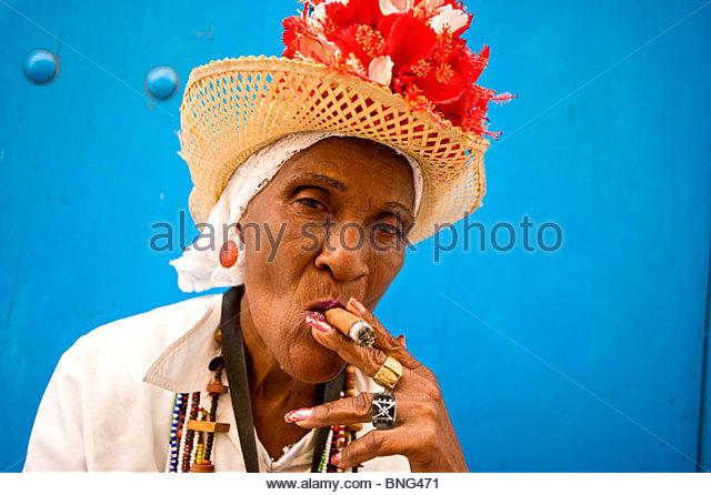 old woman smoking a Cuban cigar,Havana,Cuba - Stock Image