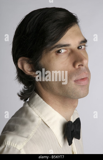 Portrait of a young man with a bow tie. - Stock Image