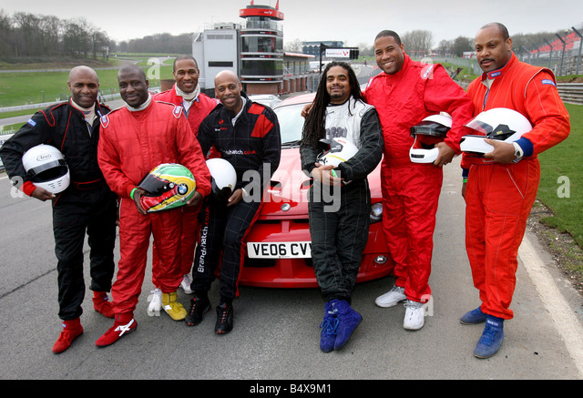 Drivers including ex footballers, try out for the first Caribbeen Racing Team at Brands Hatch today. L-R Luther - Stock Image